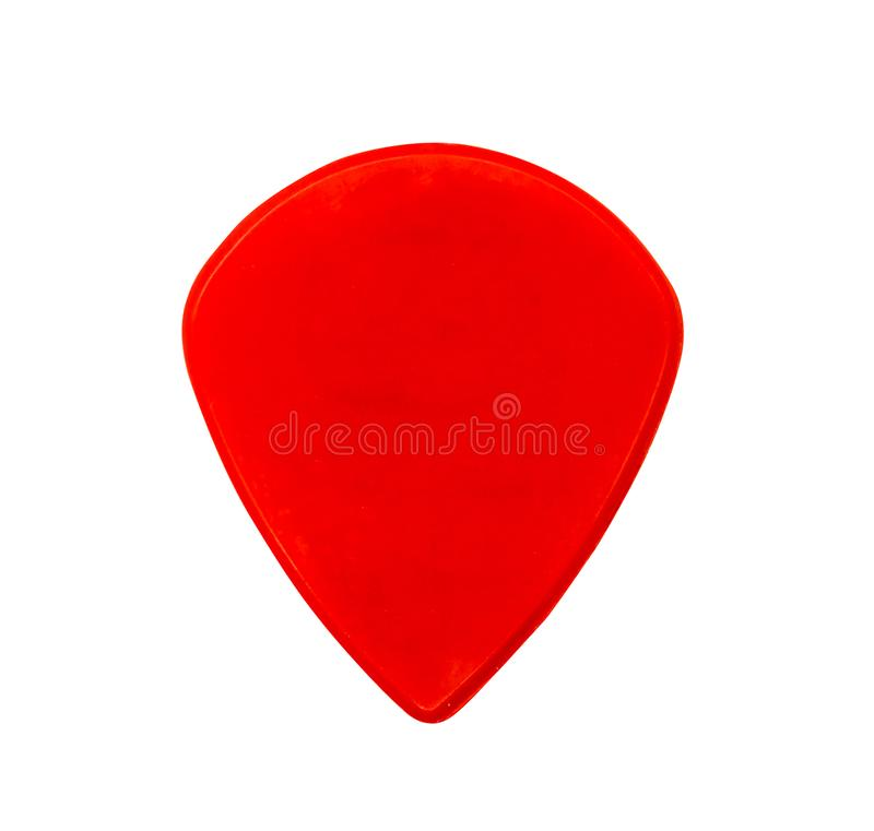 Red plastic guitar thick or heavy pick isolated on white royalty free stock image