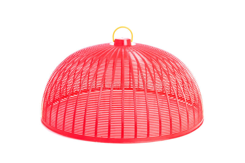Red plastic mesh cover (used to cover food to protect from insects) isolated on white royalty free stock images