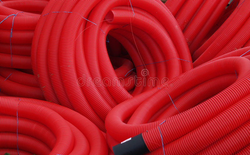 Red plastic pipes stock image