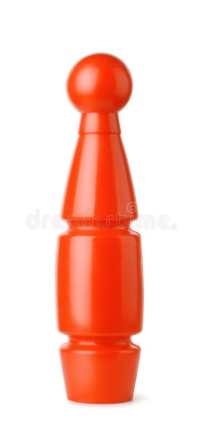 Red plastic toy bowling skittle. Front view of red plastic toy bowling skittle pin isolated on white royalty free stock photos