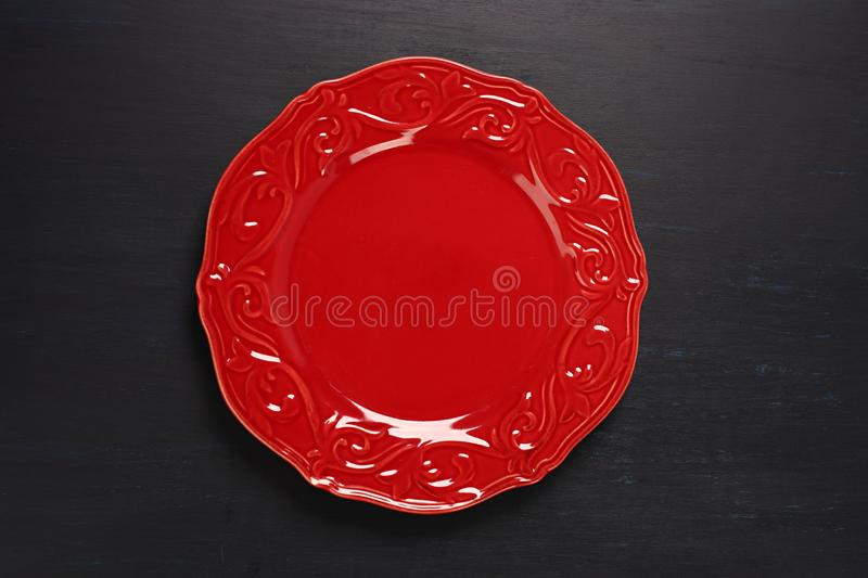 Red plate on dark background royalty free stock photography