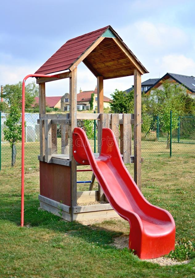 Red playground slide royalty free stock images