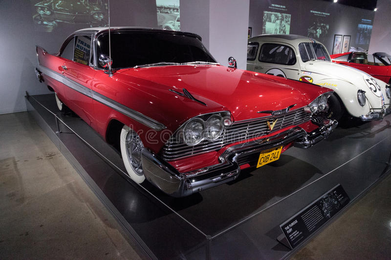 Red 1958 Plymouth Fury stunt car. Los Angeles, CA, USA - March 4, 2017: Red 1958 Plymouth Fury stunt car from the movie Christine from the collection of Martin royalty free stock images
