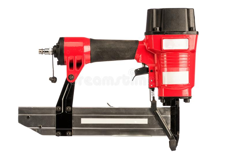 Red pneumatic stapler on a white background. Isolated stock photography