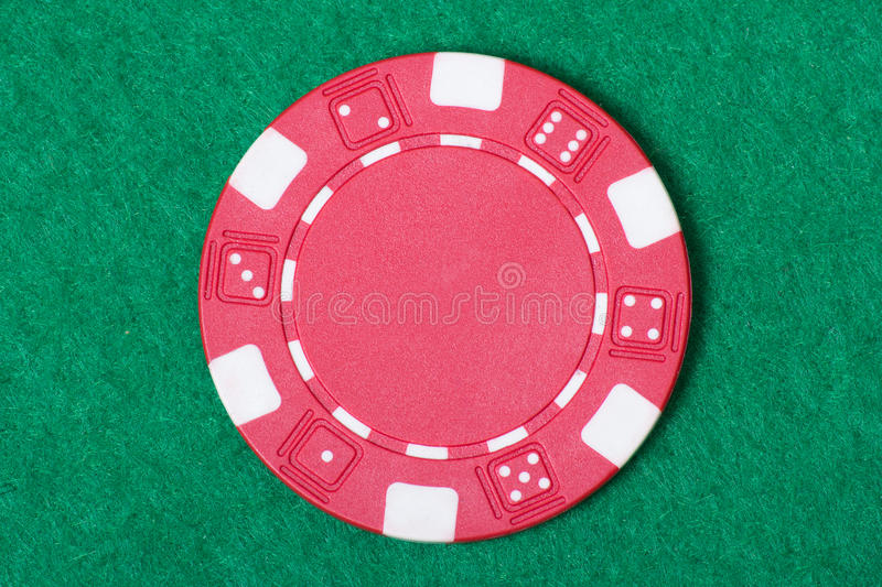 Red poker chip on the casino table. Red poker chip on the green casino table stock photos