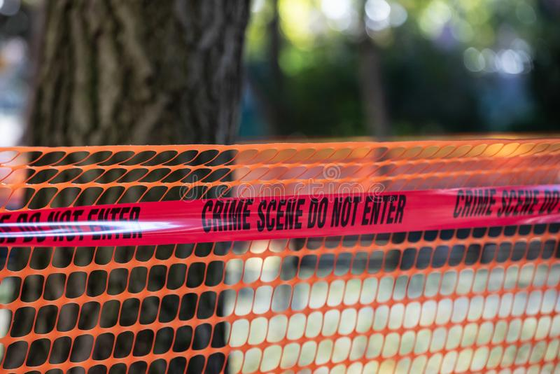 Police tape with `Crime scene do not enter` stock photos