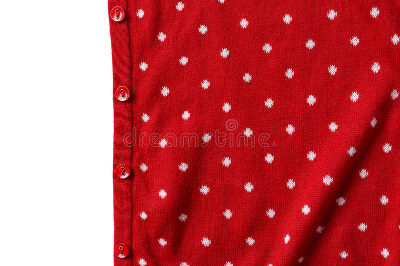 Red polka dot knit sweater with button. Red polka dot knit sweater fabric with button texture background royalty free stock photos