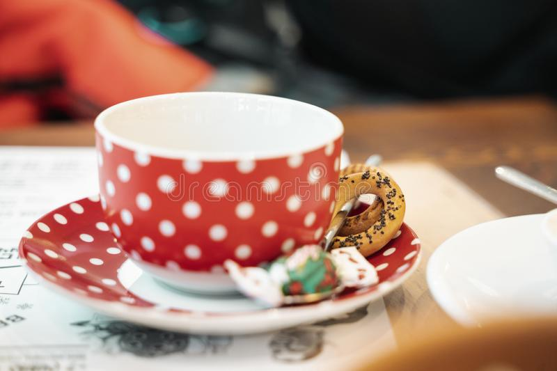 Red polka dot mug with crackers royalty free stock photography