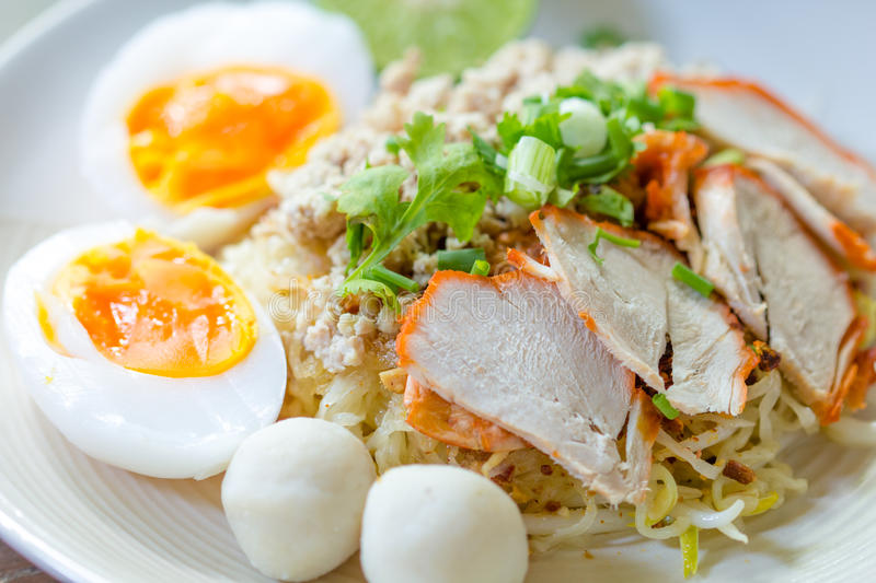 Red pork noodle. Chinese Style red pork noodle with boiled eggs stock photo