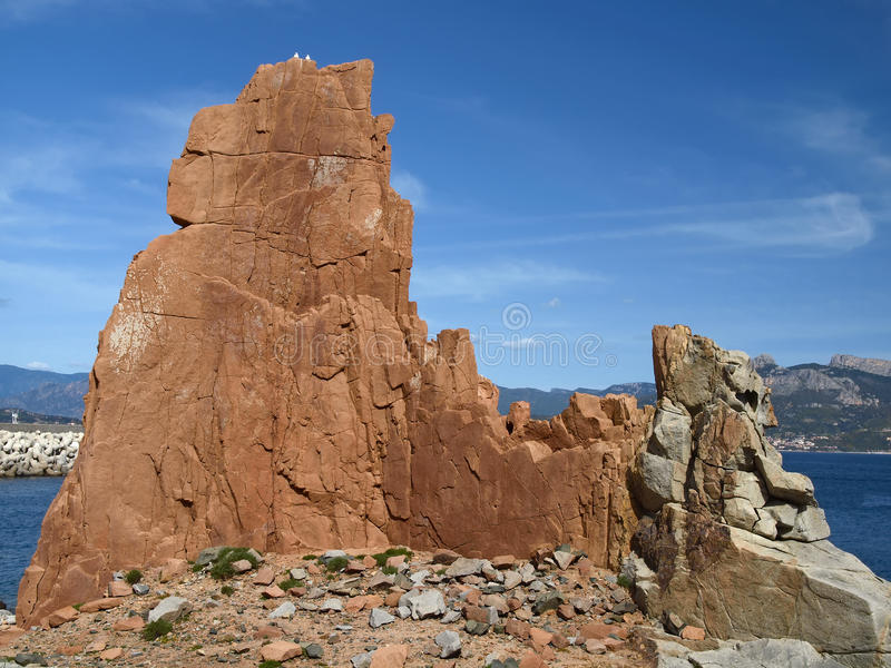 Red porphyry rocks, Arbatax, Sardinia, Italy royalty free stock images