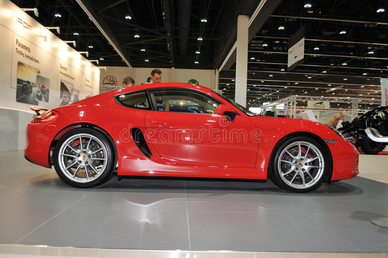 Red Porsche Cayman at the show. Red Porsche Cayman car at Porsche Pavilion in Abu Dhabi International Hunting and Equestrian Exhibition (ADIHEX) 2013 in Adbu stock photos