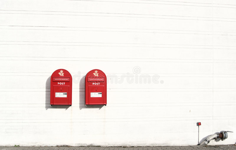 Red post boxes stock images