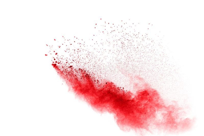 Red powder explosion isolated on white background. Red dust on white bacground royalty free stock photo