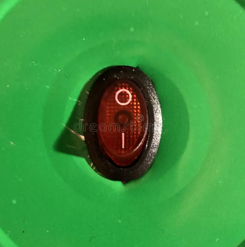 Red power button on green background with shadow. Switch, push, control, electric, electrical, electricity, energy, isolated, light, off, plastic, start stock image