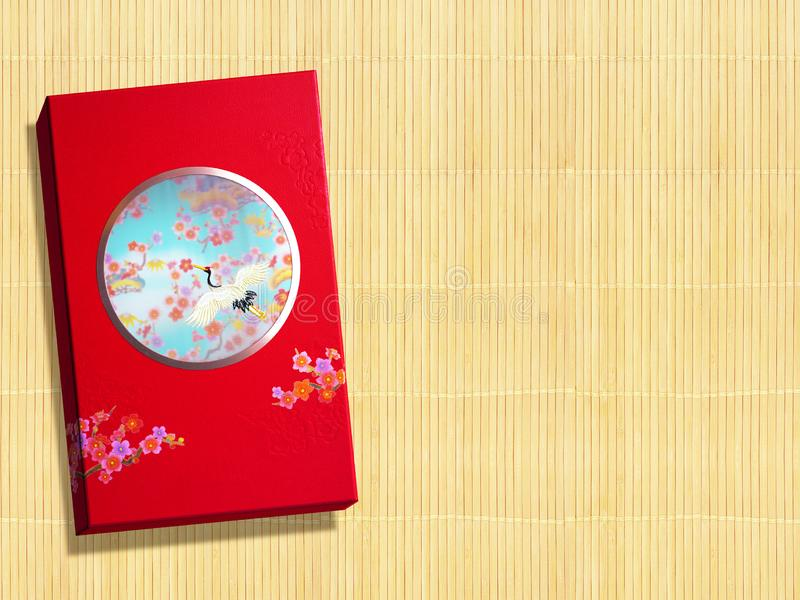 Red premium Chinese gift box for Chinese New Year, Anniversary, Mid-Autumn Festival, Valentine`s Day, Birthday. On bamboo. Background stock photography
