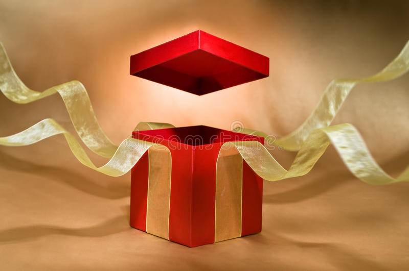 Red Present Box with open cover. And yellow flying ribbon royalty free stock photography
