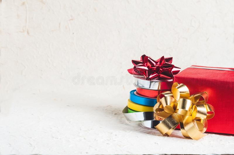 Red present with colorful ribbons royalty free stock photography