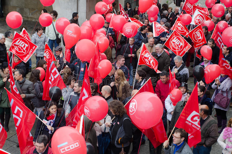 Red protest. Groups of people demonstrated by Labor Day, where unions protest against the various social cuts approved by the Government of Spain, held on MAY 1 royalty free stock photography
