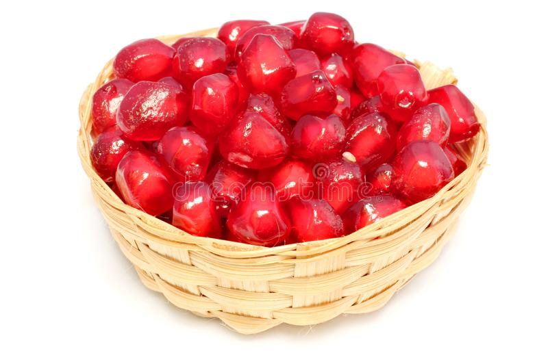 Red Pulp of pomegranate fruit on bamboo basket stock photo