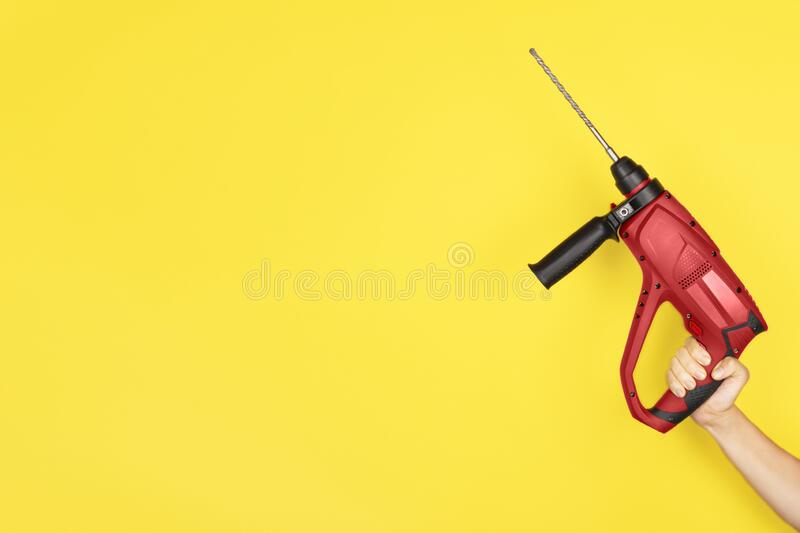 Red Puncher in the hands of a builder royalty free stock photos