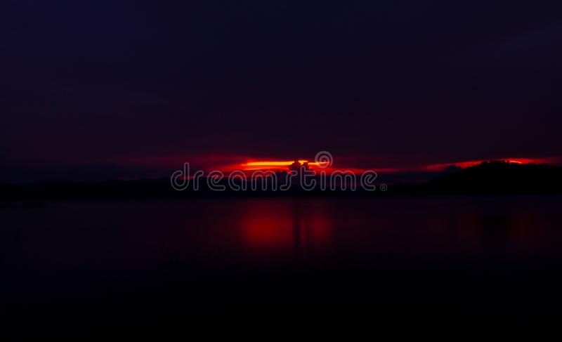 Red and purple sunset sky at the mountain and lake. Beautiful evening sky. Majestic sunset sky. Nature background. Art picture. Of sky at dusk. Sunset abstract royalty free stock photo