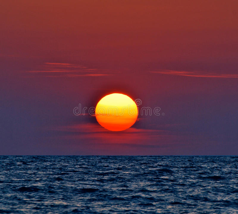 red purple sunset on water stock photography