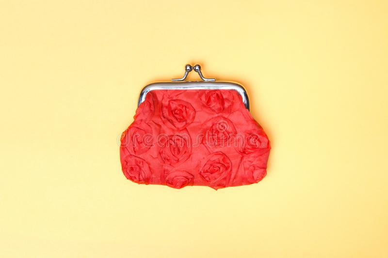 Red purse on a yellow background. Red wallet for coins royalty free stock photo