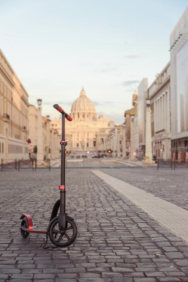 Red push scooters against the backdrop of the Vatican in the Roma, Italy. Vertical royalty free stock images