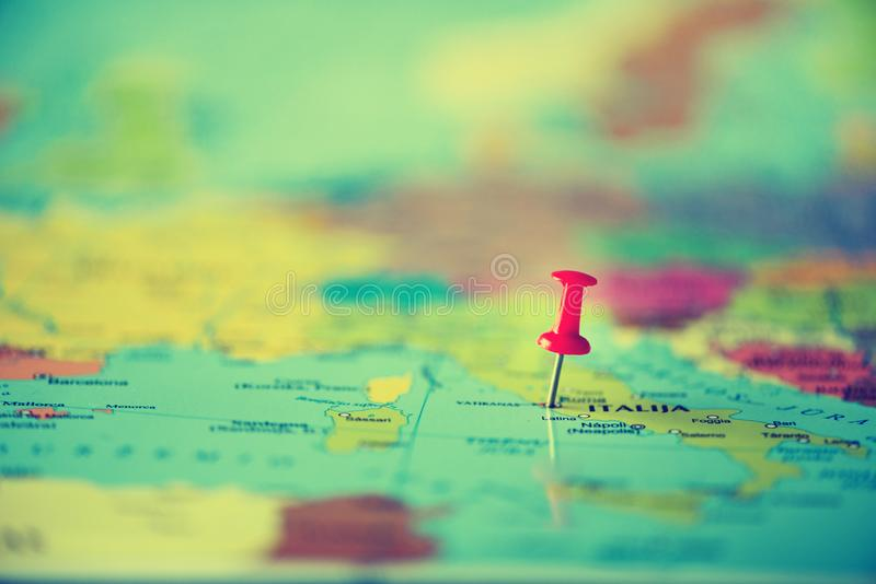 Red pushpin, thumbtack, pin showing the location, travel destination point on map. Copy space, lifestyle concept stock image