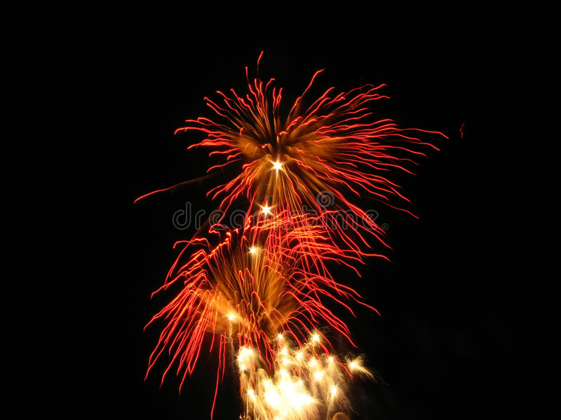 Red pyrotechnics. Beautiful red fireworks over night sky royalty free stock images