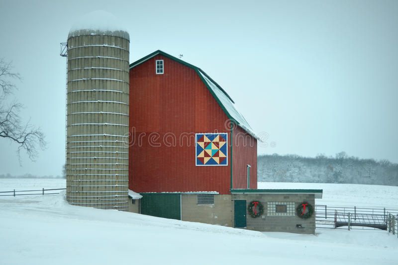 Red Quilt Barn in Winter. One of Walworth County's famous red quilt barns located on Highway 50 in Bloomfield Township located in Wisconsin. A beautiful red barn royalty free stock image