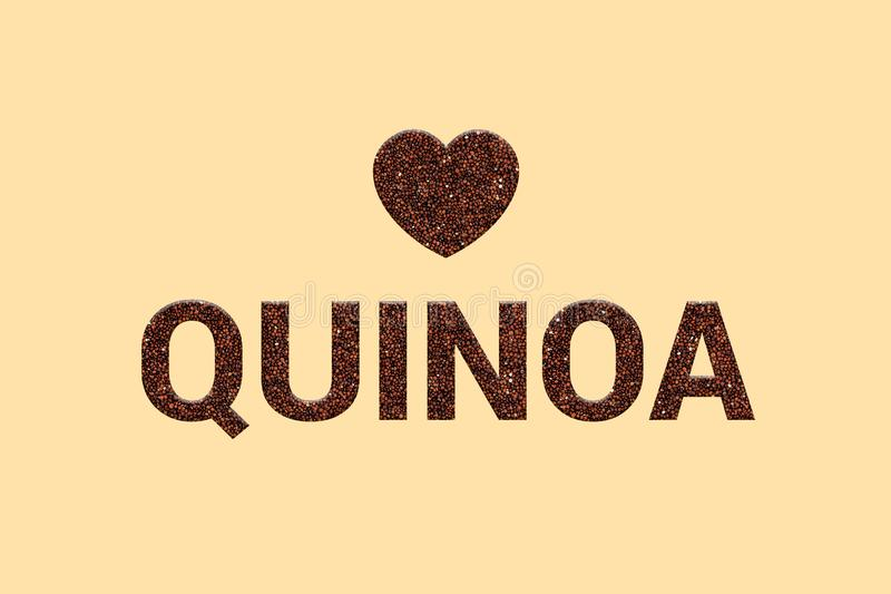 Red Quinoa super food grains texture text with heart on pastel color background. stock photo