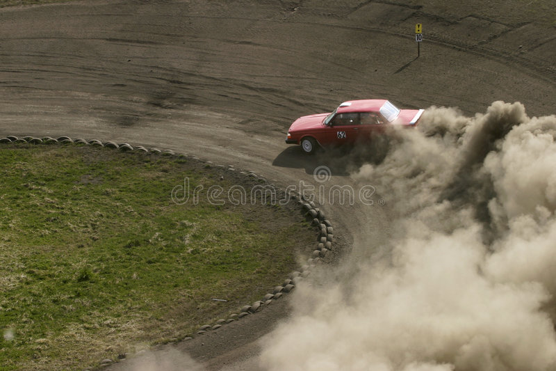 Red racing car. Racing car driving on a racing track royalty free stock photos