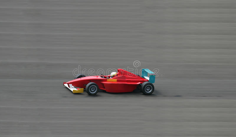 Red Racing Car. Shot with blurred background royalty free stock images