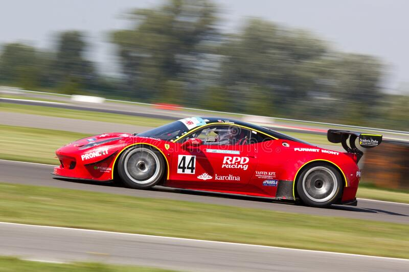 Red Racing Car on Race Track during Daytime royalty free stock photos