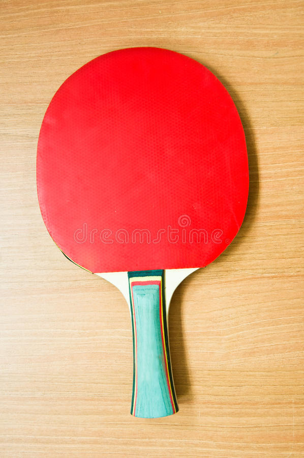 Red racket for ping-pong royalty free stock photo