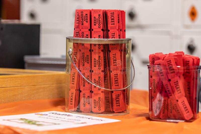 Red raffle tickets in jar royalty free stock images
