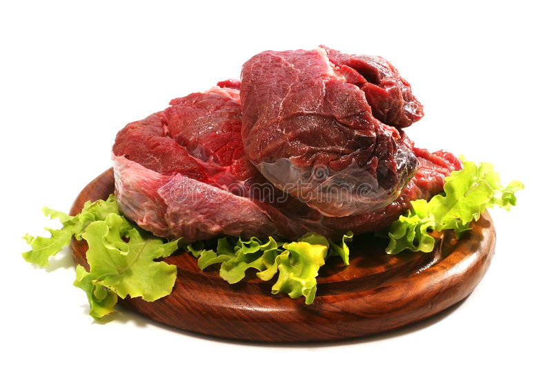 Red raw beef meat and salad over white stock photo