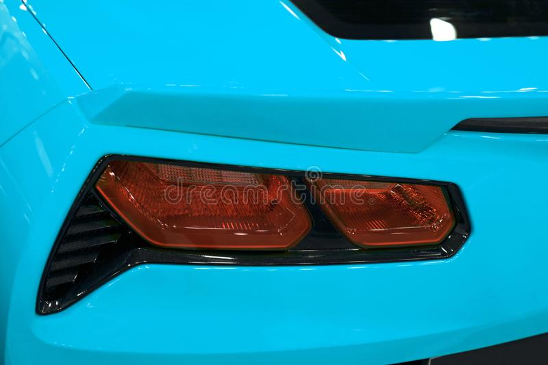 Red Rear light on a modern blue sport car with reflection. The Closeup Back Red Tail light car. stock photos