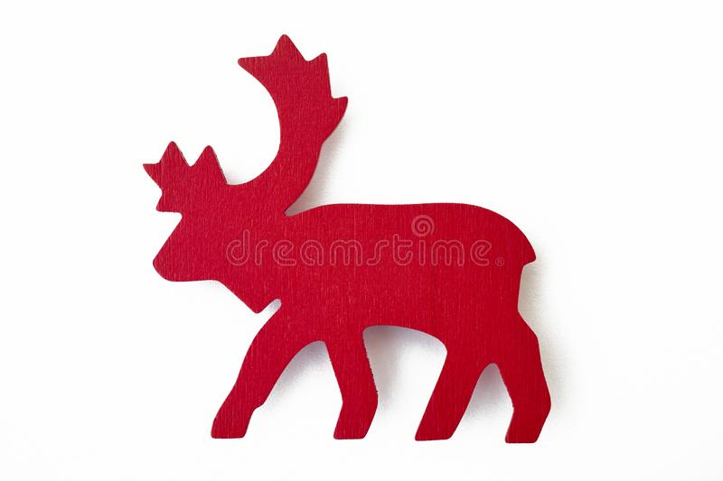 Red reindeer wooden christmas figure isolated on white. Decoration stock images