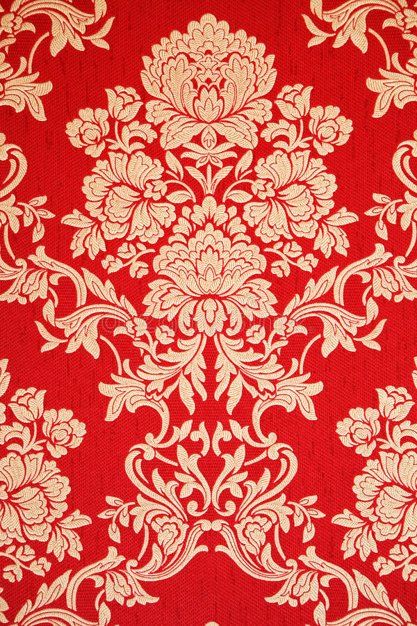 Red renaissance wallpaper with golden floral texture royalty free stock images