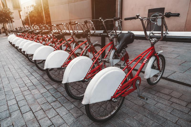 Red rental cycles in urban settings royalty free stock image