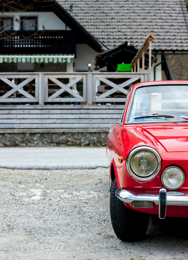 Red retro car in the countryside. Beautiful red retro sport car in the spring countryside stock images