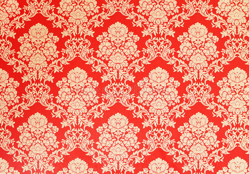 Red retro wallpaper with golden floral texture, victorian design. Red vintage wallpaper with golden rose design, baroque ornaments stock photography