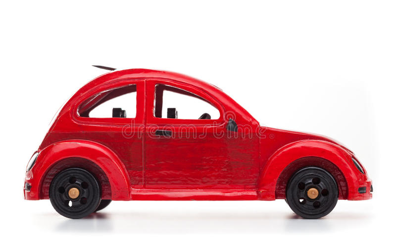 Red retro wooden toy car isolated on white background royalty free stock photography