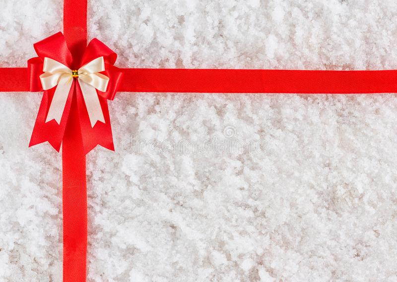 Red ribbon and bow on snow stock images