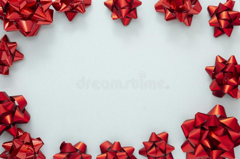 Red ribbon bows over blue background. Birthday, Christmas or Valentine& x27;s day mock up frame or border stock images