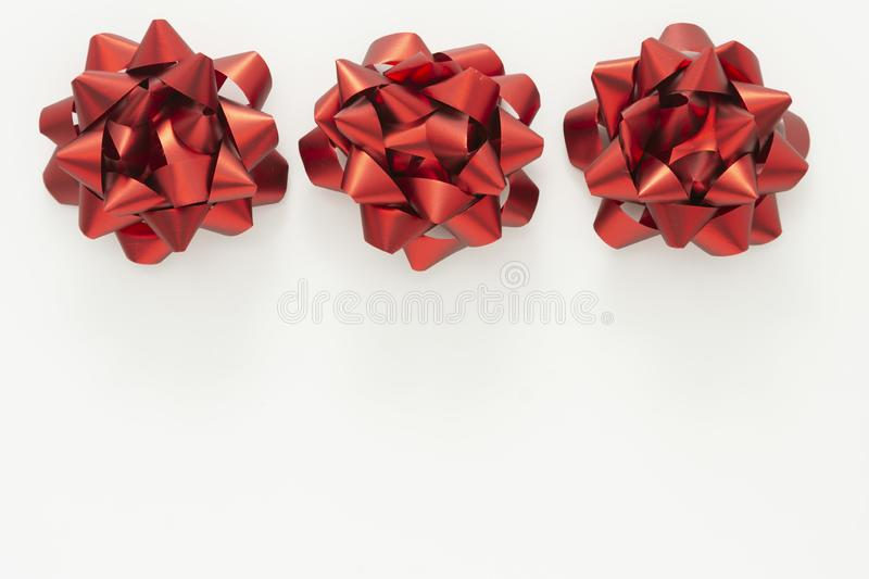 Red ribbon bows over white background. Birthday, Christmas or Valentine's day mock up frame or border stock photo