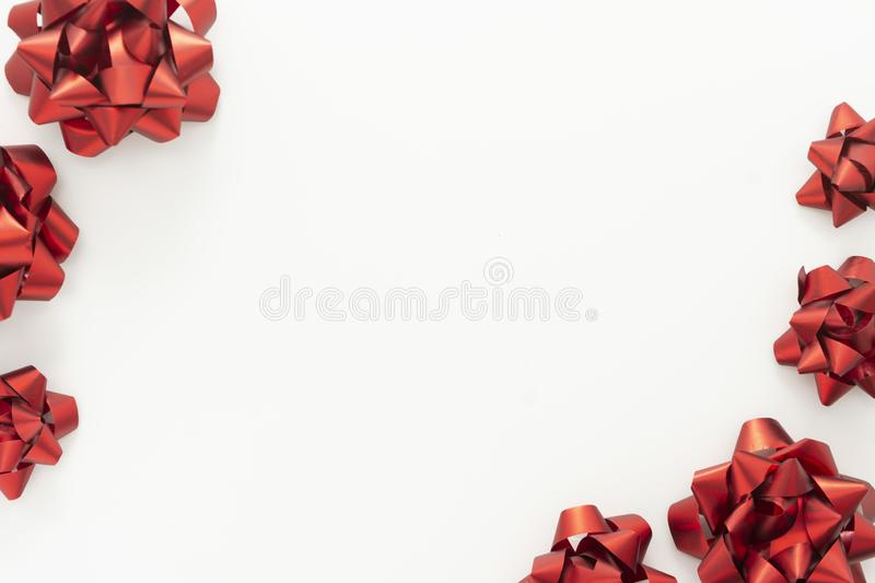 Red ribbon bows over white background. Birthday, Christmas or Valentine& x27;s day mock up frame or border royalty free stock images