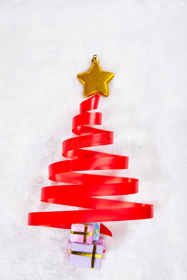 Red ribbon christmas tree stock photo image of star for Red ribbon around tree
